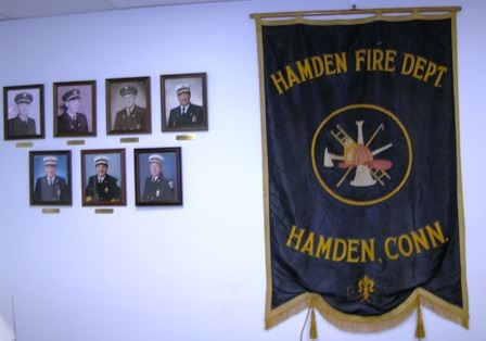 Fire Department wall with photos and a banner