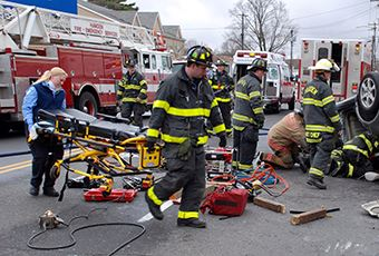 Fire fighters carrying a stretcher