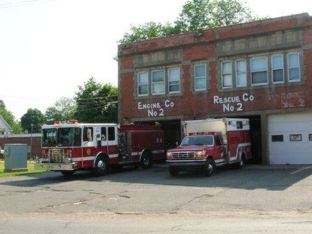 Station 2 building with two trucks